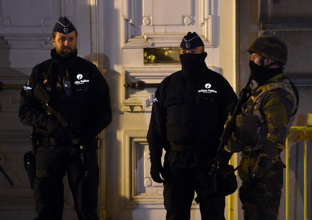 This file photo shows Belgian policemen and a serviceman secure an area during a press conference by the Belgian prime minister concerning the country's security alert level in Brussels on November 22, 2015.