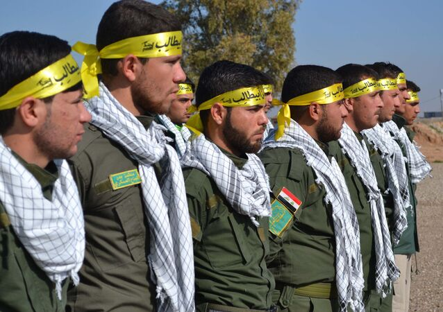Fighters from the Iraqi Imam Ali Brigade, belonging to the Badr Organisation headed by former Iraqi Transport Minister Hadi al-Amiri, take part in a graduation ceremony in Taza Khurmatu, 20 kms south of Kirkuk, on February 26, 2015.