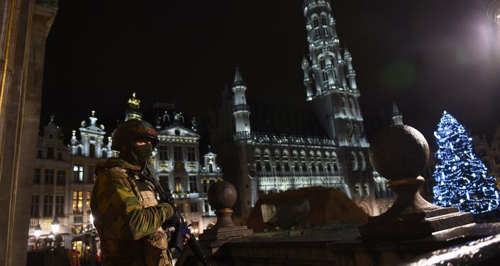A Belgian soldier stands guard around a security perimeter as a reported police intervention takes place around the Grand Place central square in Brussels on November 22, 2015. Brussels will remain at the highest possible alert level with schools and metros closed over a serious and imminent security threat in the wake of the Paris attacks, the Belgian prime minister said.