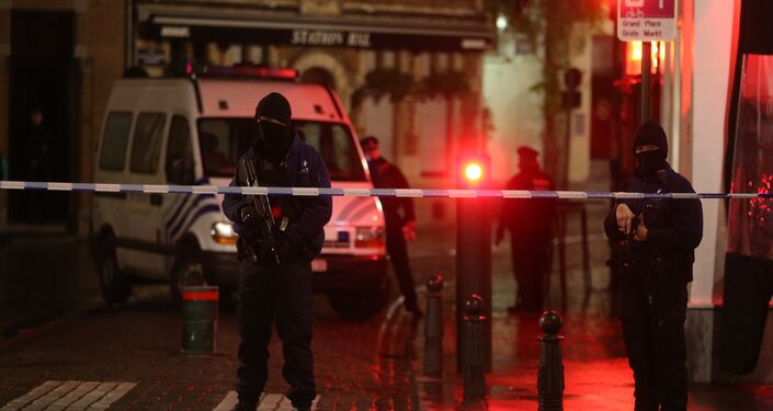 Belgian police officers secure an area in Brussels on November 22, 2015. Brussels will remain at the highest possible alert level with schools and metros closed over a serious and imminent security threat in the wake of the Paris attacks, the Belgian prime minister said.
