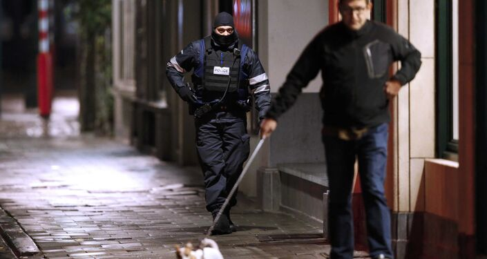 Belgian police officers search the area during a continued high level of security following the recent deadly Paris attacks in Brussels