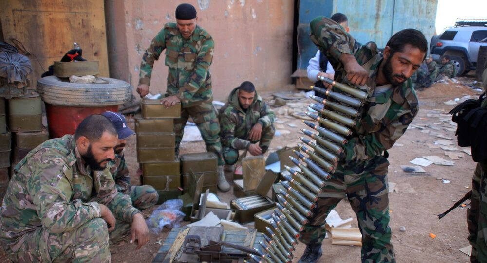 File Photo: Syrian pro-government forces prepare their weapons at a train station in the area of Arkile near the airport of Kweyris, in the northern Syrian province of Aleppo, on November 20, 2015