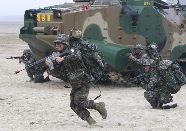 South Korean Marines come out from a landing craft during a landing exercise on the beach in Taean, western South Korea, Monday, June 29, 2015