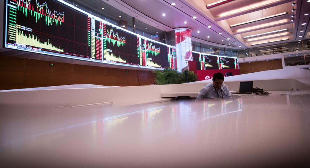 A man works on the trading floor at the Shanghai Stock Exchange in the Lujiazui Financial district of Shanghai on September 22, 2015