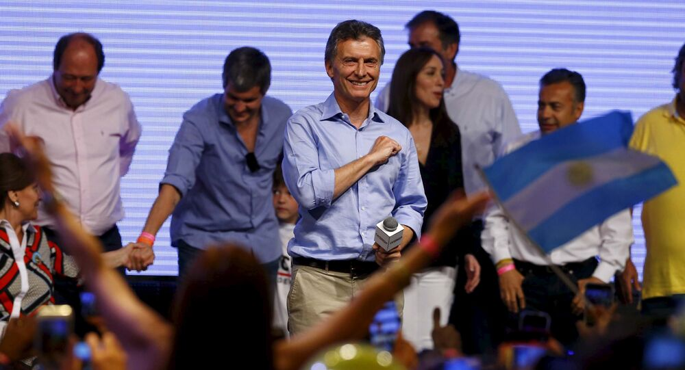 Mauricio Macri, presidential candidate of the Cambiemos (Let's Change) coalition, gestures to his supporters after the presidential election in Buenos Aires, Argentina, November 22, 2015