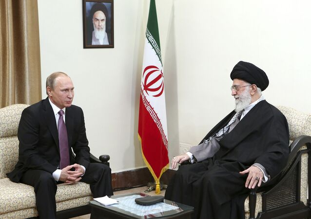 In this Monday, Nov. 23, 2015 photo released by an official website of the office of the Iranian supreme leader, Supreme Leader Ayatollah Ali Khamenei, right, listens to Russian President Vladimir Putin during their meeting in Tehran, Iran