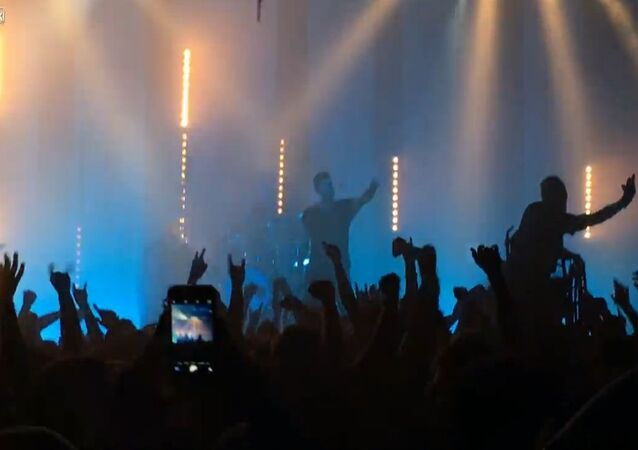 Dude on wheelchair crowd surfs during concert