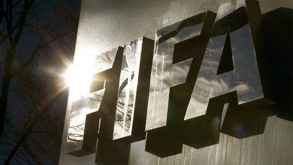 The sun is reflected in FIFA's logo in front of FIFA's headquarters in Zurich, Switzerland November 19, 2015 - Sputnik International