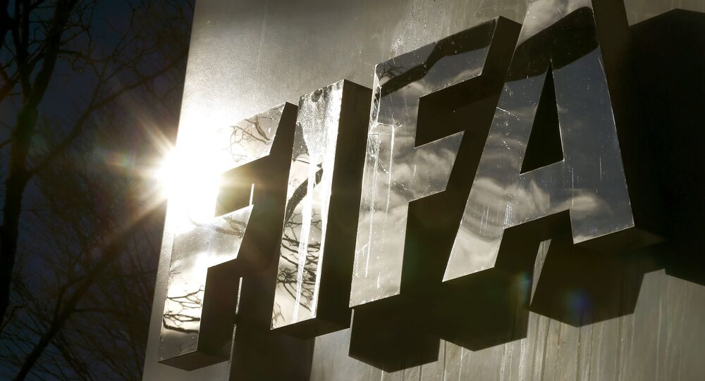 The sun is reflected in FIFA's logo in front of FIFA's headquarters in Zurich, Switzerland November 19, 2015