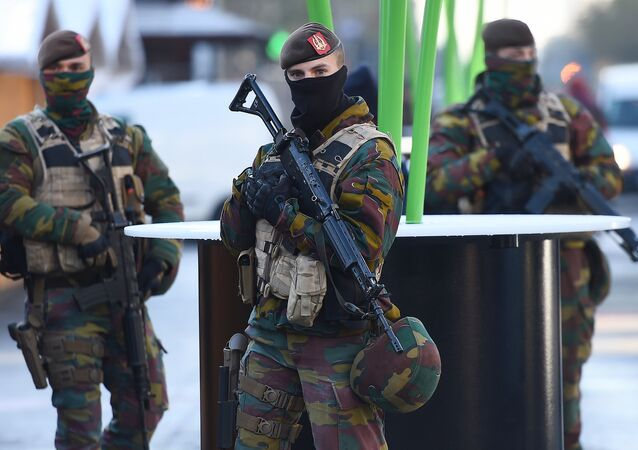 Soldiers patrol as the Belgian capital remains on the highest possible alert level on November 23, 2015 in Brussels