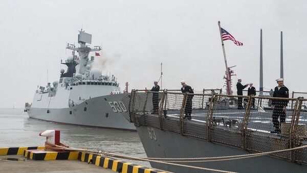 SHANGHAI (Nov. 20, 2015) Sailors aboard the forward-deployed Arleigh Burke-class guided missile destroyer USS Stethem (DDG 63) prepare to leave port while the People's Liberation Army Navy Jiangkai II class guided-missile frigate Xuzhou (FFG 530) gets underway - Sputnik International