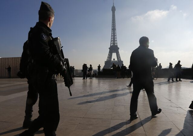 French police officers patrol near the Eiffel Tower, in Paris.