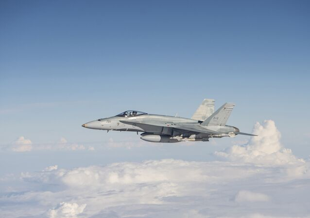 A Royal Canadian Air Force CF-188 Hornet flies over Iraq on November 7, 2015, during Operation IMPACT.