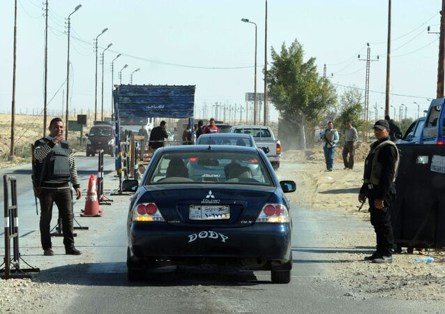 Egyptian police inspect cars at a checkpoint in North Sinai on January 31, 2015