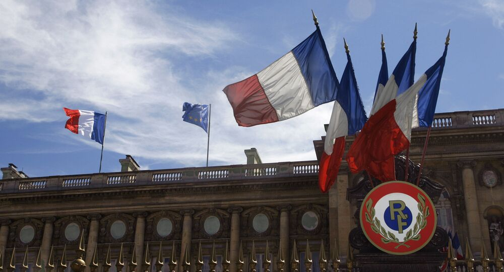 Picture shows French flags and the European flag hauled up, 13 July 2007 on the Foreign affairs minister building in Paris