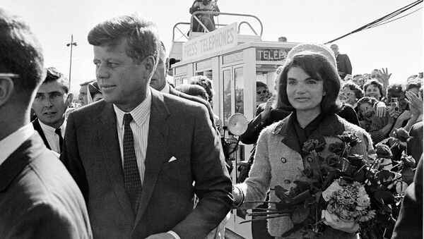 President John F. Kennedy and his wife Jacqueline Kennedy are greeted by an enthusiastic crowd upon their arrival at Dallas Airport, on November 22, 1963. Only a few hours later the president was assassinated while riding in an open-top limousine through the city. - Sputnik International