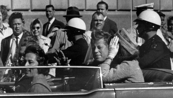 President John F. Kennedy is seen riding in motorcade approximately one minute before he was shot in Dallas, Tx., on Nov. 22, 1963. In the car riding with Kennedy are Mrs. Jacqueline Kennedy, right, Nellie Connally, left, and her husband, Gov. John Connally of Texas. - Sputnik International