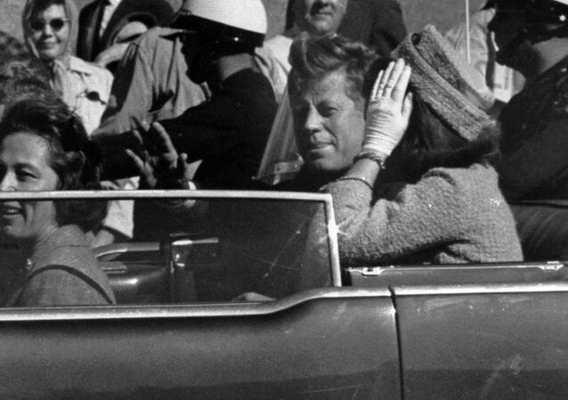 President John F. Kennedy is seen riding in motorcade approximately one minute before he was shot in Dallas, Tx., on Nov. 22, 1963. In the car riding with Kennedy are Mrs. Jacqueline Kennedy, right, Nellie Connally, left, and her husband, Gov. John Connally of Texas.
