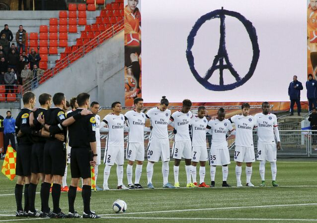 Football Soccer - Lorient v Paris St Germain - French Ligue 1 - Moustoir stadium, Lorient, France - 21/11/2015Soccer players of Paris St Germain observe a minute of silence to pay tribute to victims of the Paris attacks, before their French Ligue 1 soccer match against Lorient