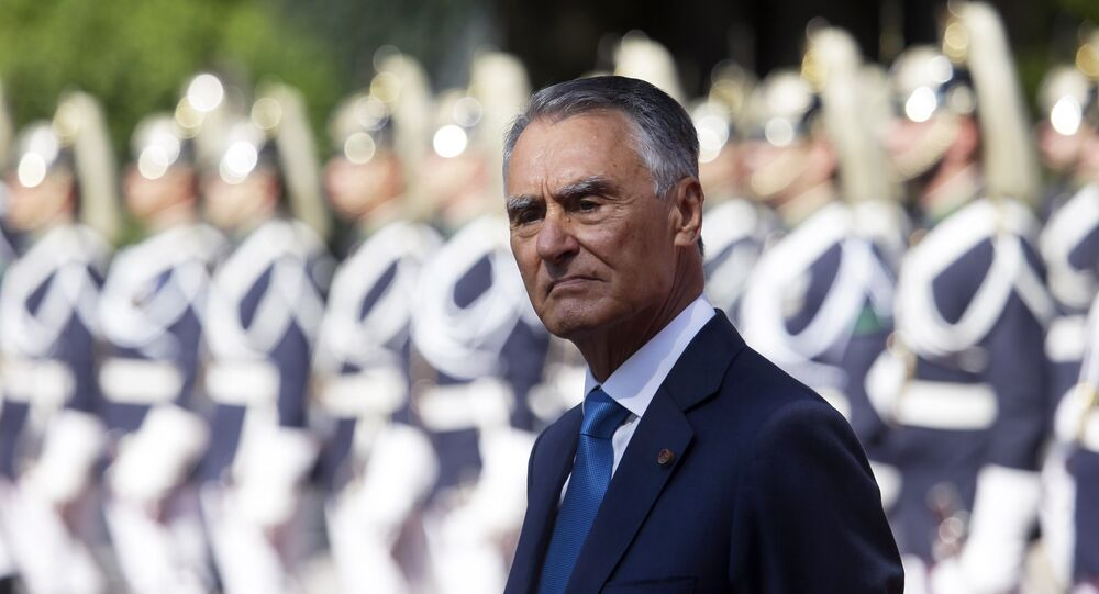 Portuguese President Anibal Cavaco Silva stands in front of a honor guard while waiting for the arrival of Senegal's President Macky Sall at the Belem presidential palace in Lisbon Tuesday, Sept. 8 2015.