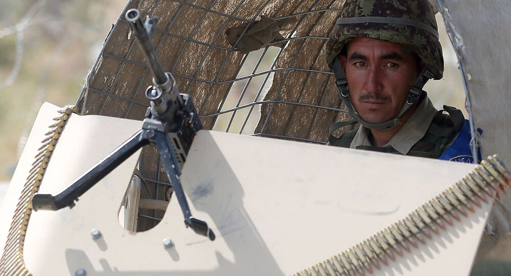 A soldiers looks on while Afghan security forces take part in an exercise in Kabul Garrison compound, in Kabul, Afghanistan, Wednesday, Oct. 7, 2015.