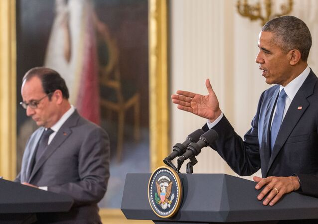 French President Francois Hollande listens as President Barack Obama speaks during their joint news conference in the East Room of the White House in Washington, Tuesday, Nov. 24, 2015
