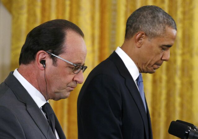 U.S. President Barack Obama (R) and French President Francois Hollande listen during a joint news conference in the East Room of the White House in Washington November 24, 2015