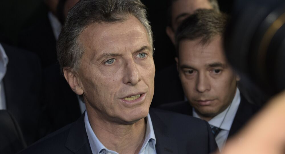 Argentine President-elect Mauricio Macri speaks to the press at the Olivos presidential residence in Buenos Aires, where he arrived to meet outgoing president Cristina Fernandez de Kirchner to define the transition, on November 24, 2015