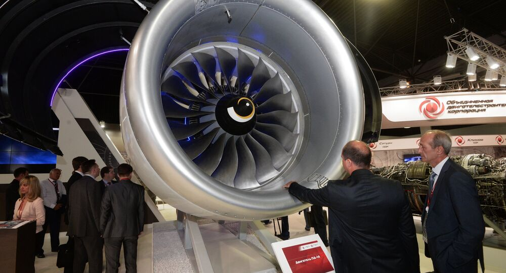 Visitors at the PD-14 aircraft engine displayed by the United Engine Corporation at the MAKS-2015 air show in Zhukovsky in the Moscow Region