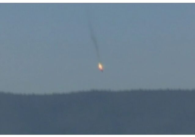 A war plane crashing in flames in a mountainous area in northern Syria after it was shot down by Turkish fighter jets near the Turkish-Syrian border, is seen in this still image taken from video November 24, 2015