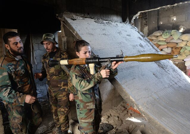 Soldiers of the Syrian Arab Army in Darayya, a Damascus suburb