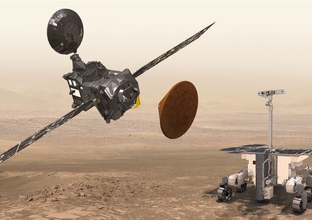 Artist's impression of the Trace Gas Orbiter (TGO, top left) and the entry, descent and landing demonstrator module, Schiaparelli (middle), and the ExoMars rover (bottom right)