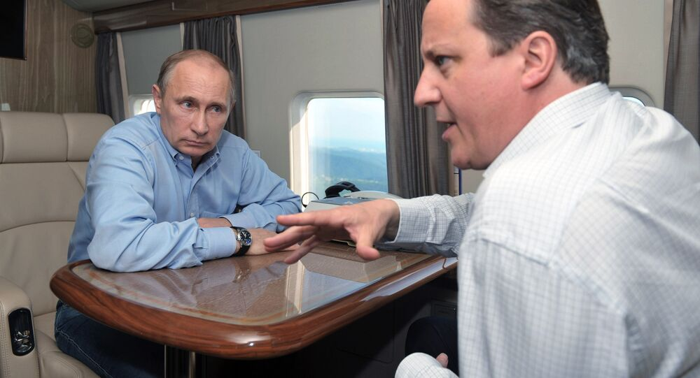 Britain's Prime Minister David Cameron (R) and Russian President Vladimir Putin on May 10, 2013.