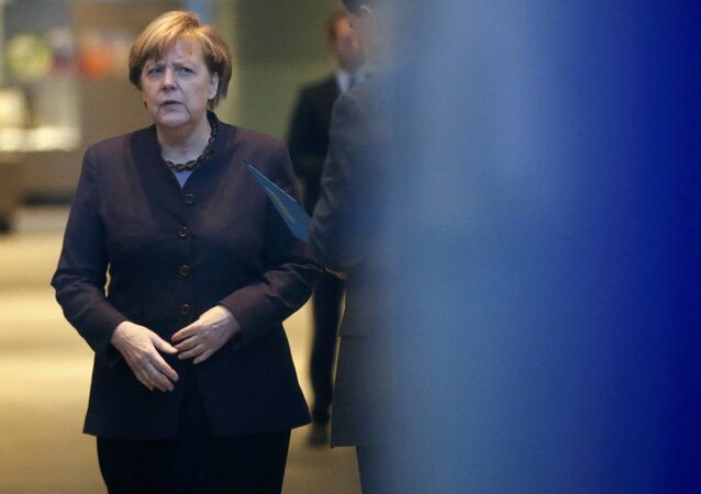 German Chancellor Angela Merkel waits to welcome Vietnam's President Truong Tan Sang at the Chancellery in Berlin, Germany, November 25, 2015.