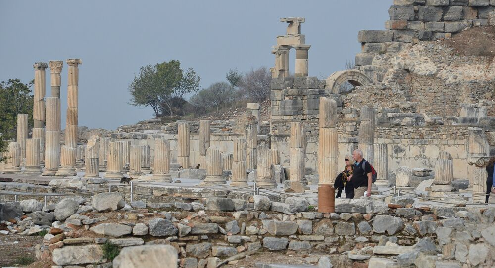 Long shot of the pillared Street of Curetes