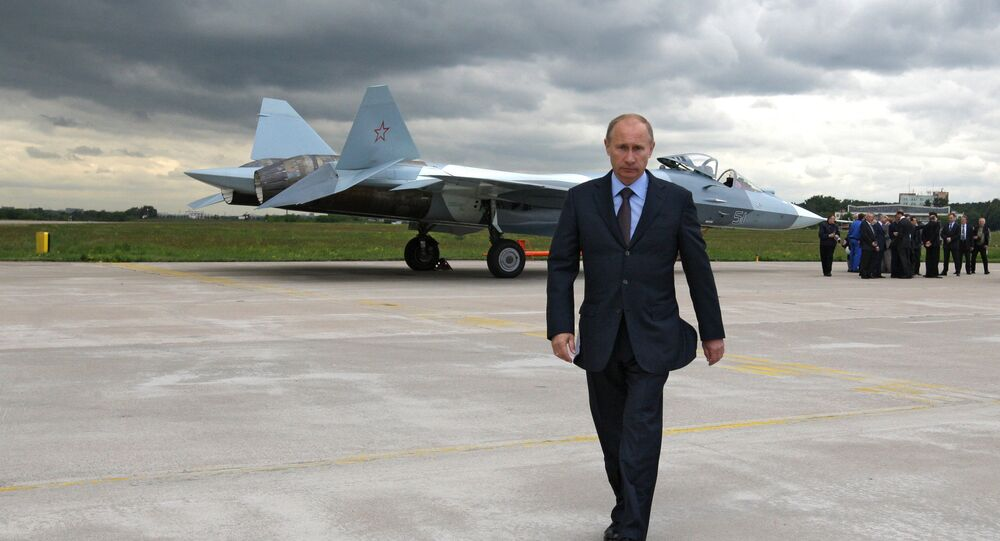 Vladimir Putin at the testing grounds of the Central Aero-Dynamic Institute (TsAGI) in Zhukovsky near Moscow after the test flight of a Sukhoi T-50 fifth generation fighter.