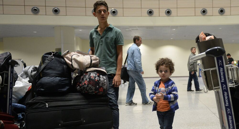 Syrian citizens who have been evacuated by a plane of the Russian Ministry for Civil Defense, Emergencies and Disaster Relief from Latakia, Syria, at Moscow's Domodedovo airport.