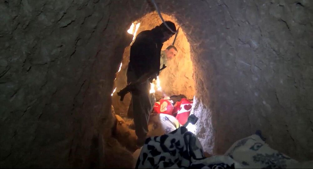 In this image made from video taken on Sunday, Nov. 22, 2015, Kurdish security forces are seen in a tunnel complex under the city of Sinjar, northern Iraq that were used by Islamic State fighters to move undetected and avoid coalition airstrikes before the town was retaken from the militants.