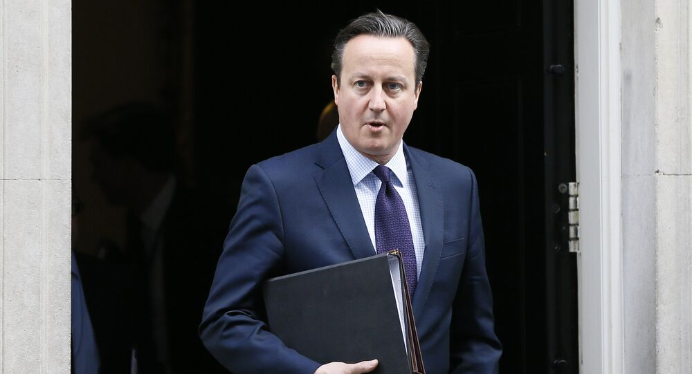 This file photo shows Britain's Prime Minister David Cameron leaves 10 Downing Street to attend Parliament in London,