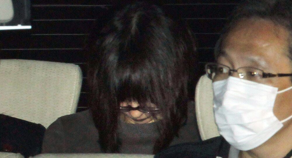 Naoko Kikuchi, an alleged former member of Japan's Aum Supreme Truth, is driven from the headquarters of the Tokyo Metropolitan Police in Sagamihara city, suburban Tokyo