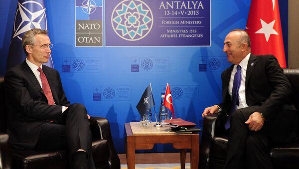 Turkish Foreign Minister Mevlut Cavusoglu (R) speaks with NATO Secretary General Jens Stoltenberg (L) during a meeting on May 12, 2015 in Antalya - Sputnik International