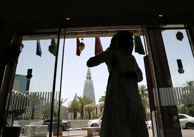 A Saudi man enters a hotel decorated for the Muslim holly month of Ramadan, Riyadh, Saudi Arabia, Monday, June 15, 2015.