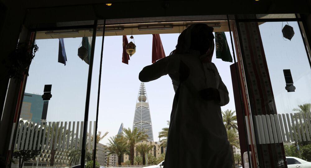 A Saudi man enters a hotel decorated for the Muslim holly month of Ramadan, Riyadh, Saudi Arabia, Monday, 15 June 2015.