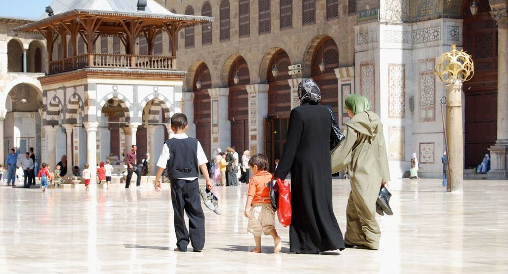 A family at the Umayyad Mosque, Damascus