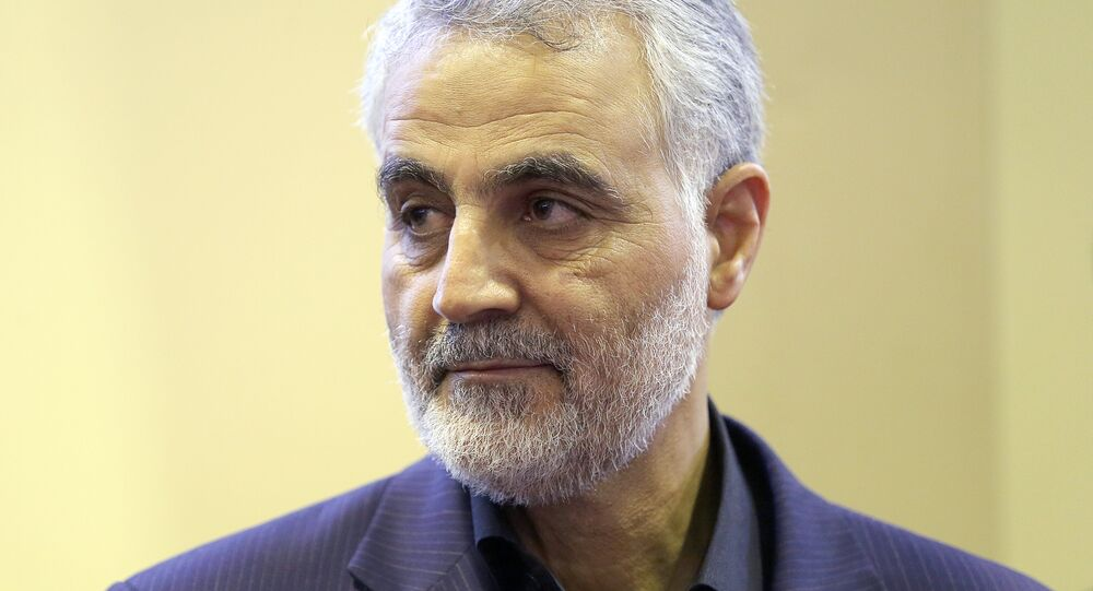 The commander of the Iranian Revolutionary Guard's Quds Force, Gen. Qassem Suleimani, is seen as people pay their condolences following the death of his mother in Tehran