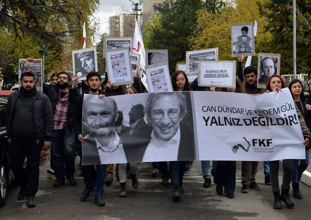 People demonstrate against the jailing of opposition Cumhuriyet newspaper's editor-in-chief Can Dundar and Ankara representative Erdem Gul, in Ankara, Turkey, Friday, Nov. 27, 2015.