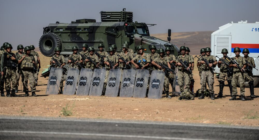 Turkish soldiers stand guar near the Turkey-Syrian border post in Sanliurfa