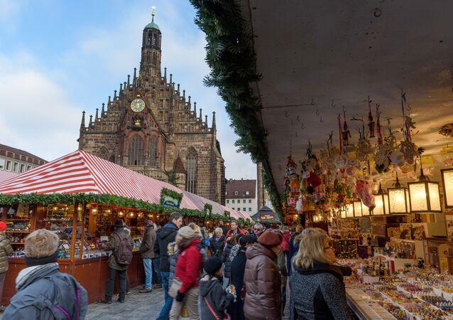 People visit a Christmas market on November 27, 2015 in Nuremberg