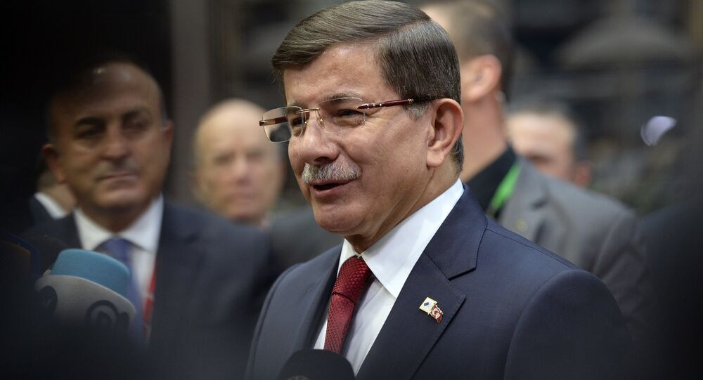 Turkish Prime Minister Ahmet Davutoglu speaks to the press as he arrives for a summit on relations between the European Union and Turkey and on the migration crisis at the EU headquarters in Brussels on November 29, 2015.