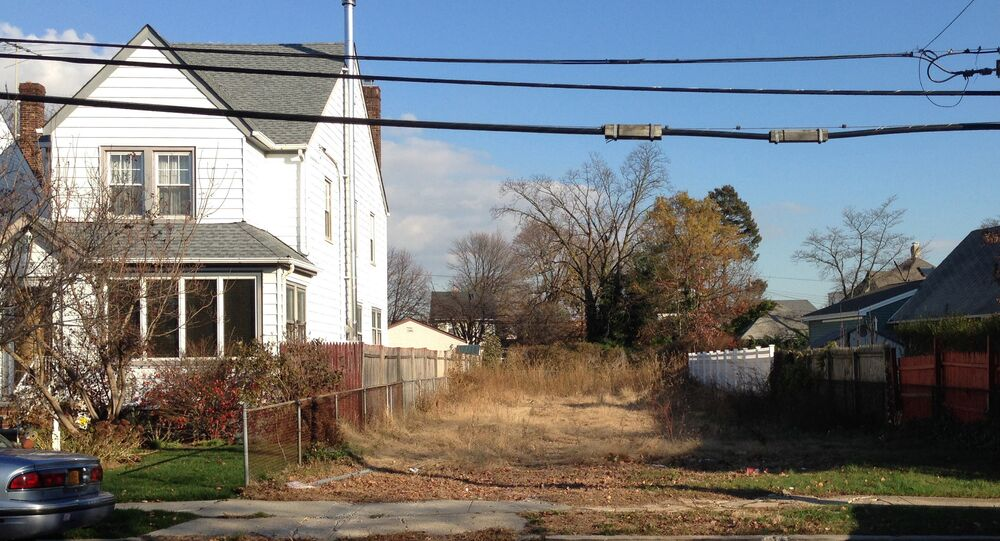 In this Nov. 25, 2015 photo, a lot stands empty in West Hempstead, N.Y., after the township had the home that once stood on it torn down. Homeowner Philip Williams says he went to Fort Lauderdale for the knee replacement in December, 2014. When he returned to the West Hempstead home in August 2015, his home was gone.